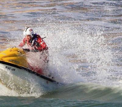 ccommons-IDSphotos-Coastguard_on_jetski_patrolling_the_surf